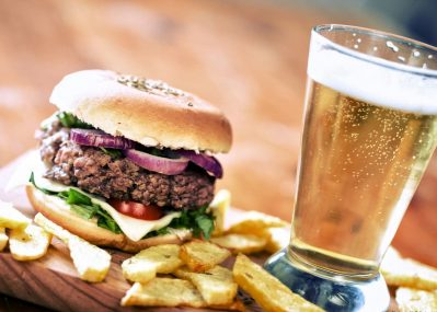 Hamburger, french fries, and beer from the Coloma Club restaurant