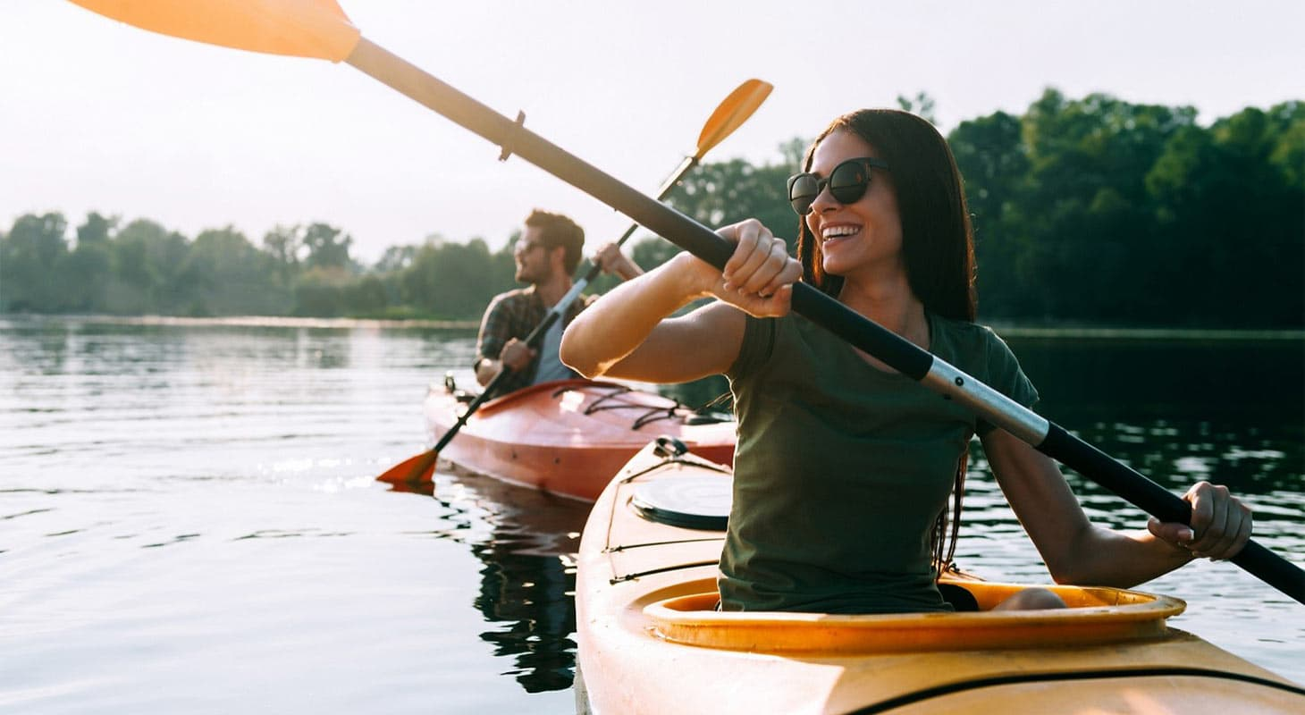 Woman and Man Kayaking in Folsom Lake