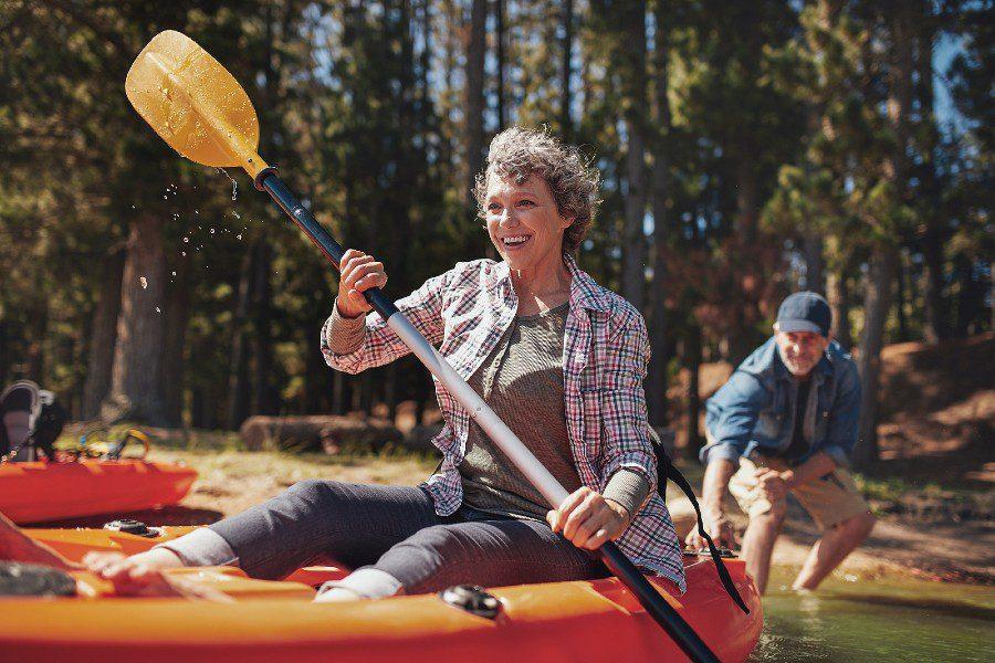 happy couple kayaking together