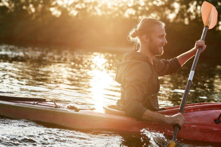 young man kayaking in Northern California
