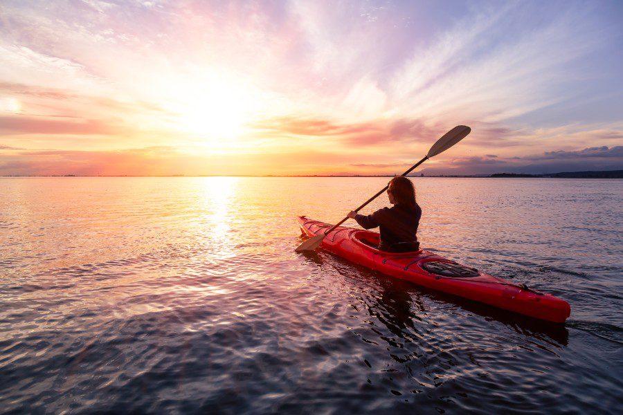 woman kayaking at sunet