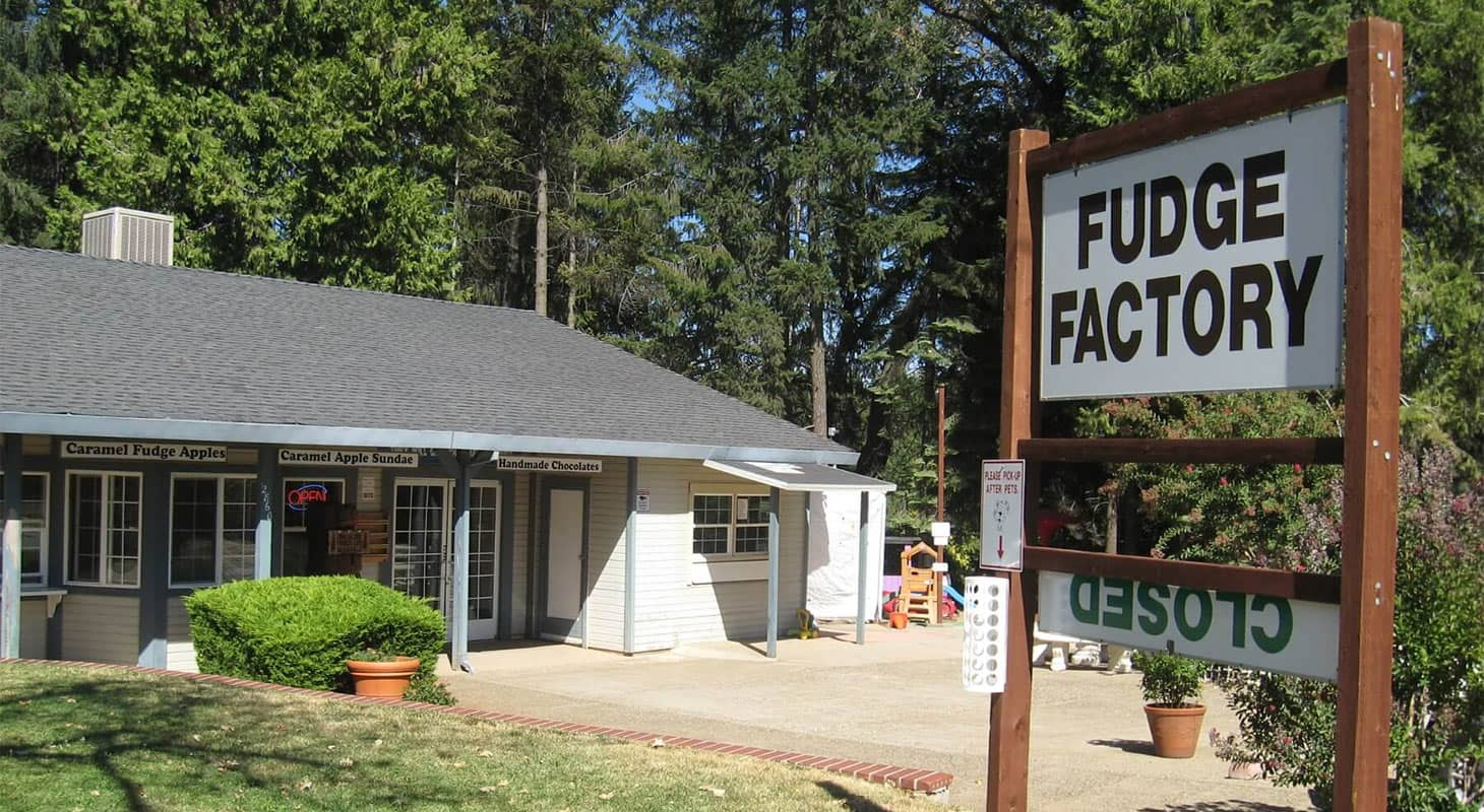 """The Fudge Factory Farm and a sign outside reading """"FUDGE FACTORY"""""""