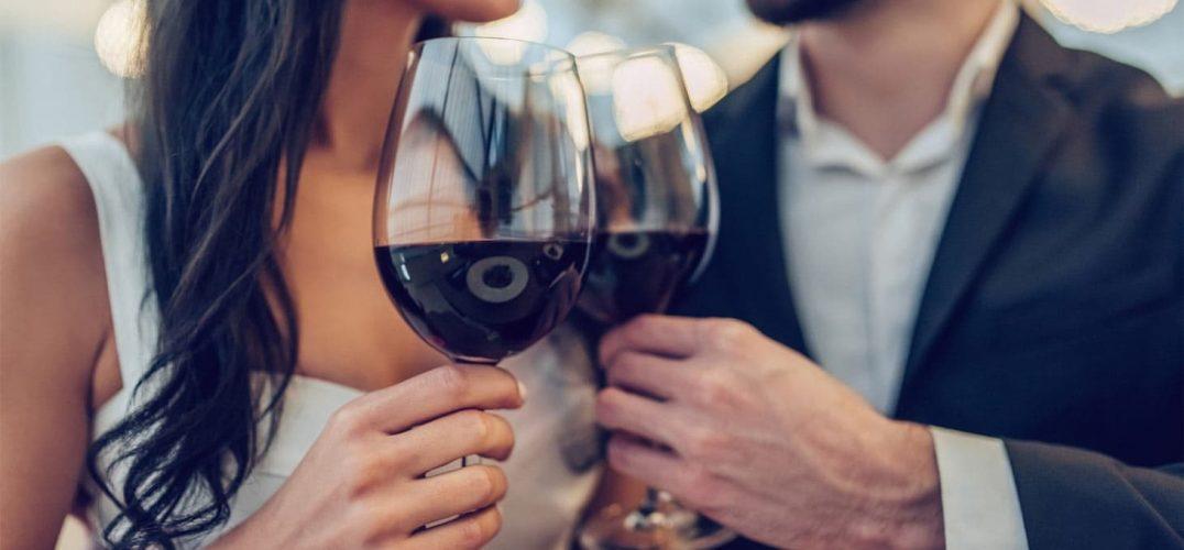 Elegant Couple toasting red wine