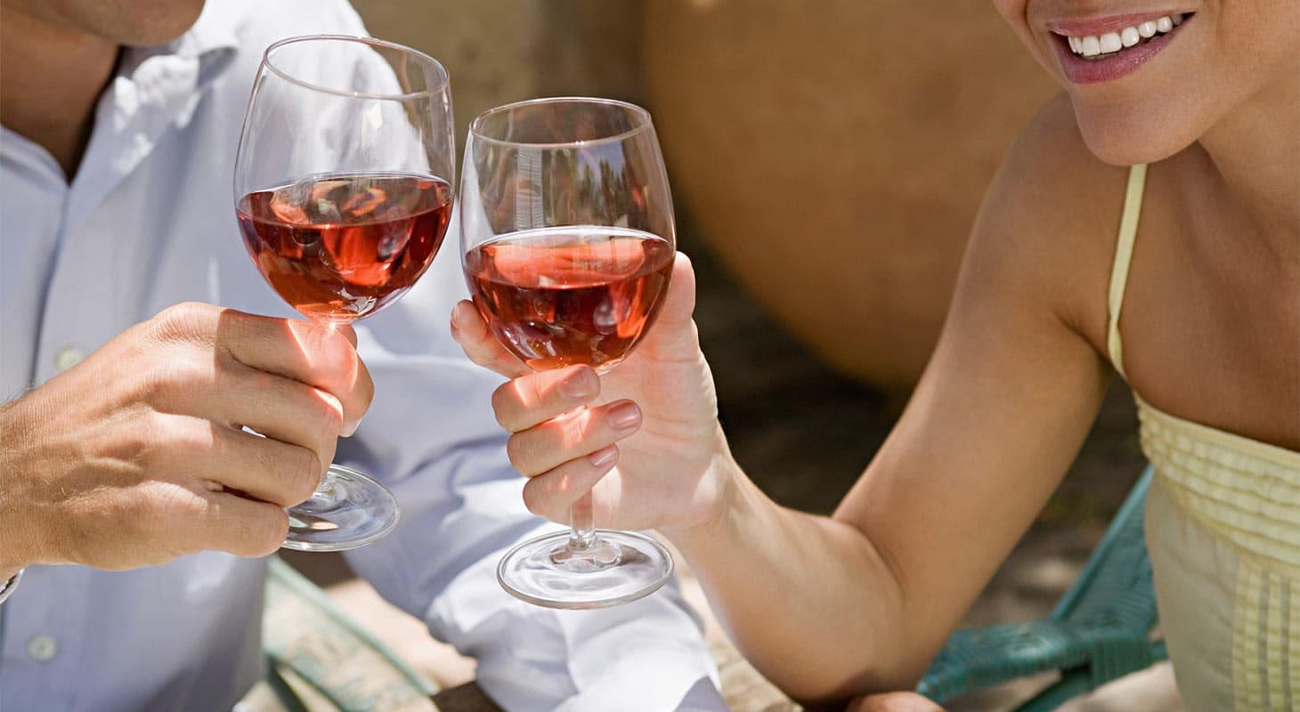 A man and woman with wine glasses at Lava Cap Winery