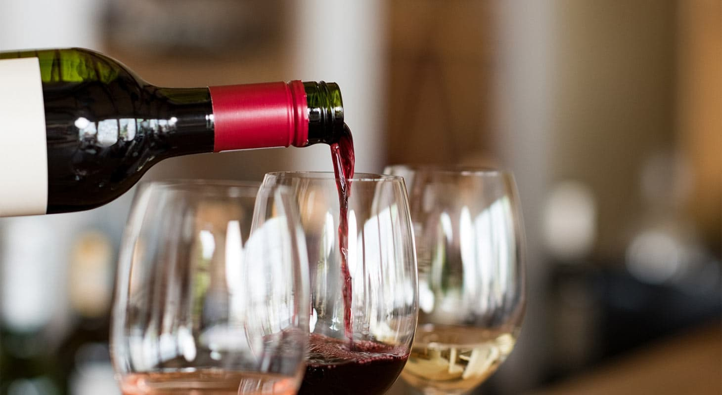 Pouring red wine into glasses at Wofford Acres Vineyards