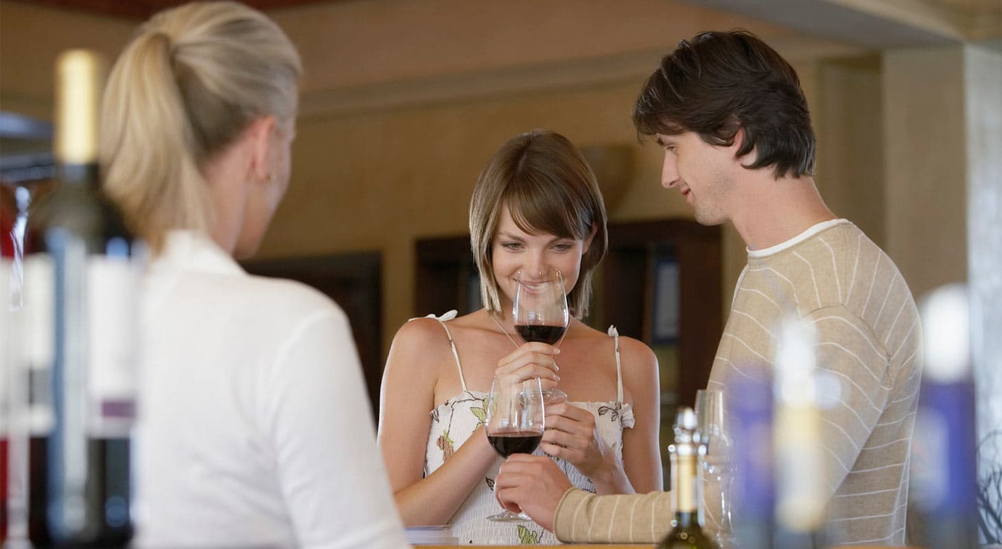 A man and woman tasting wines at the Sierra Vista Winery