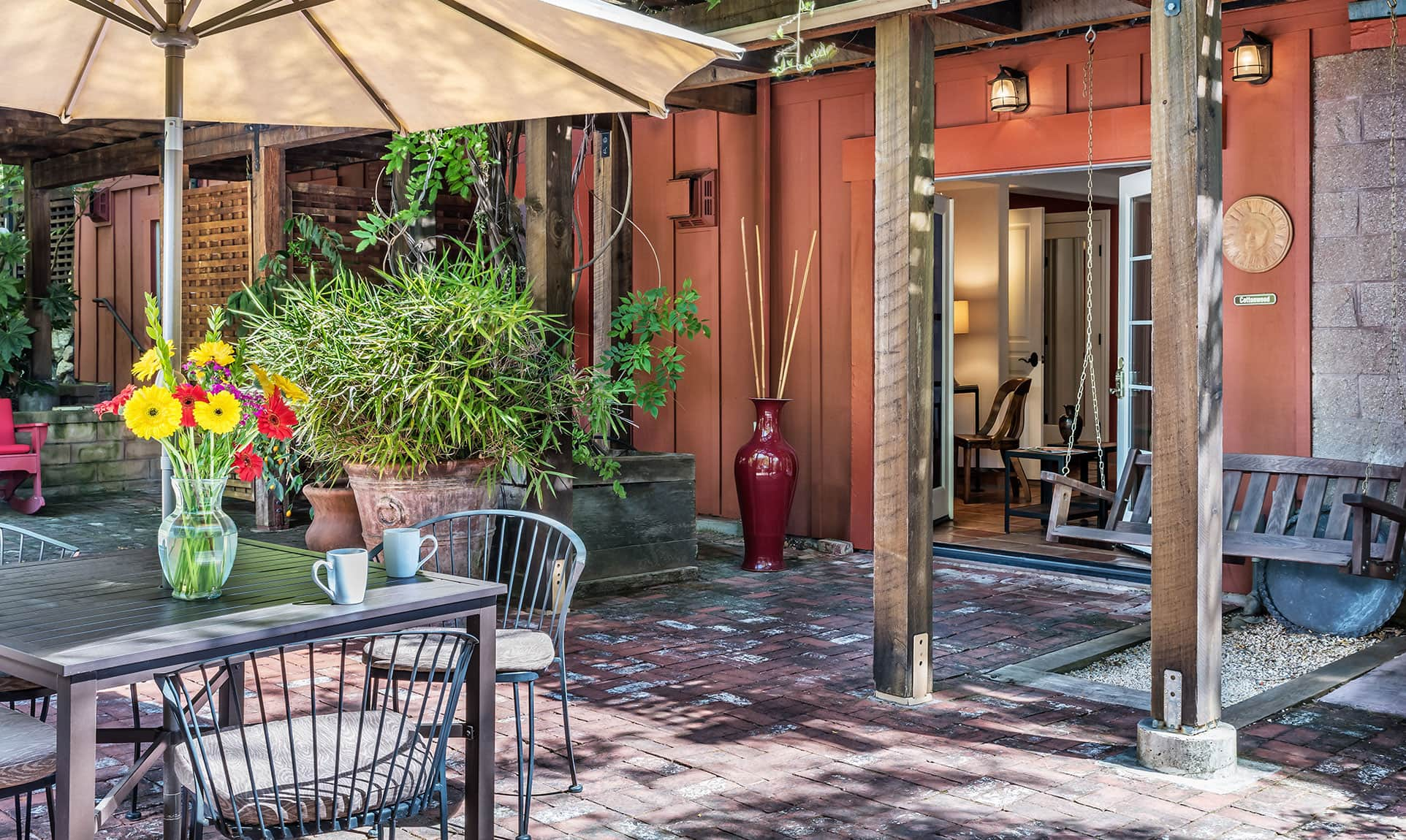 Bright patio with covered table outside the Cottonwood room