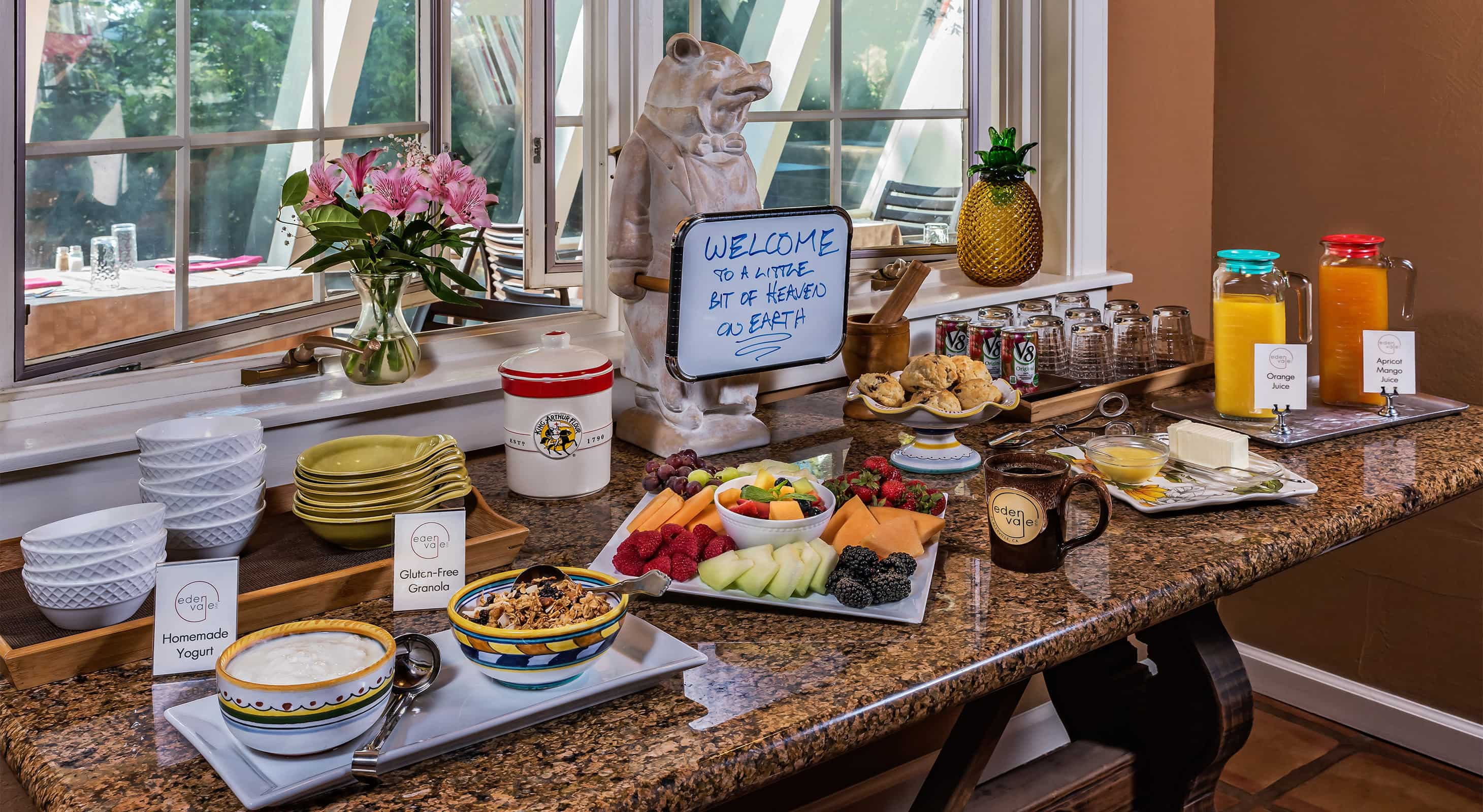 "Breakfast bar with sign that says ""WELCOME to a little bit of heaven on Earth"""