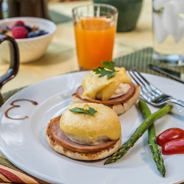Breakfast plate with Eggs Benedict and asparagus
