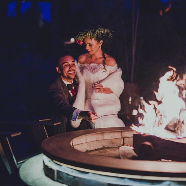 Bride and Groom sitting by the firepit