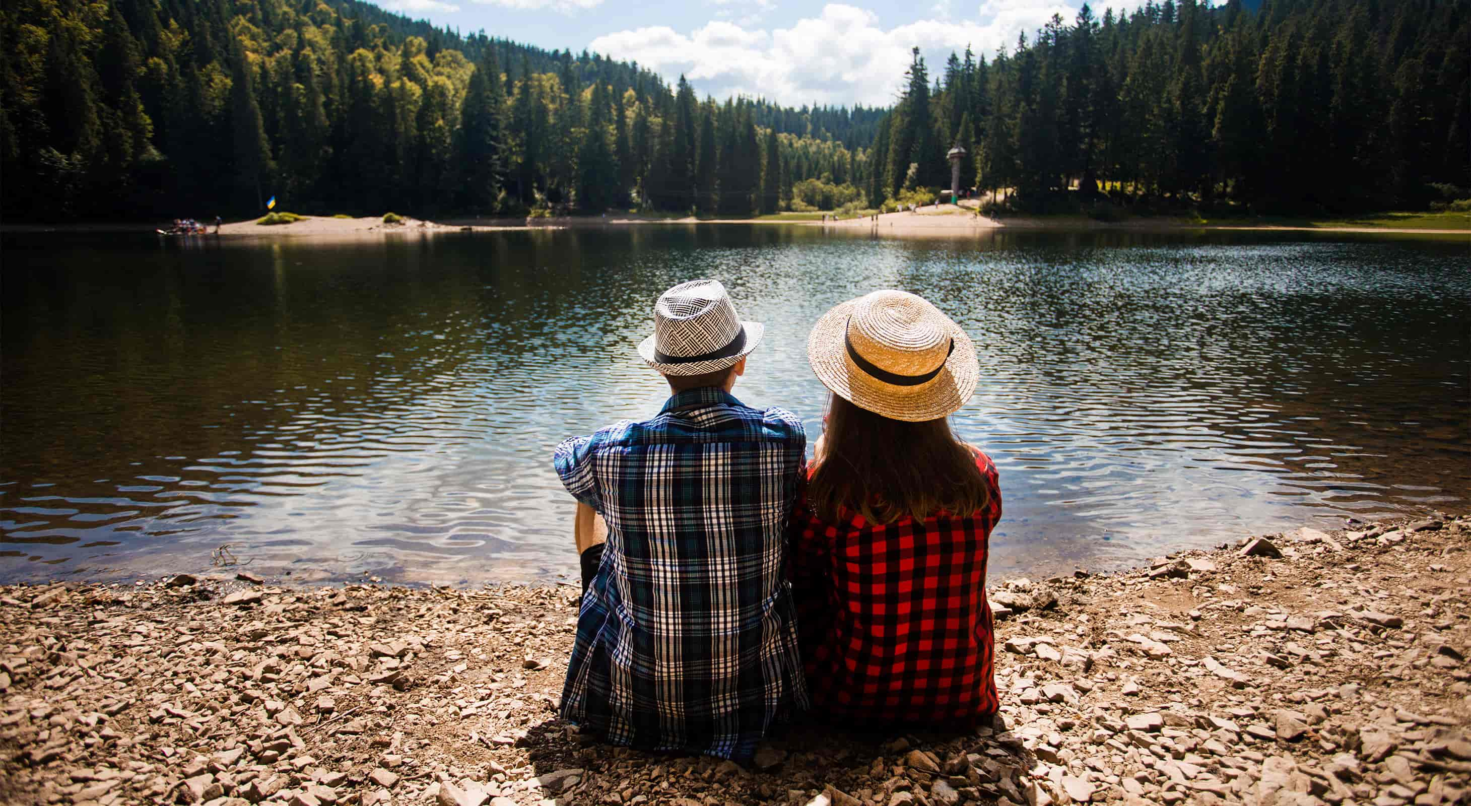 Young Couple sitting by a lake in California