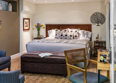 Soft bed by sitting area in the Cypress Room