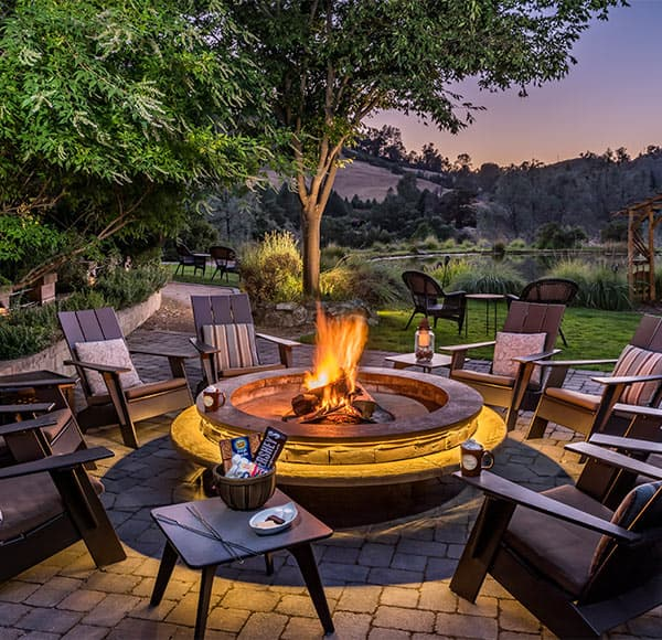Chairs around the fire pit at night
