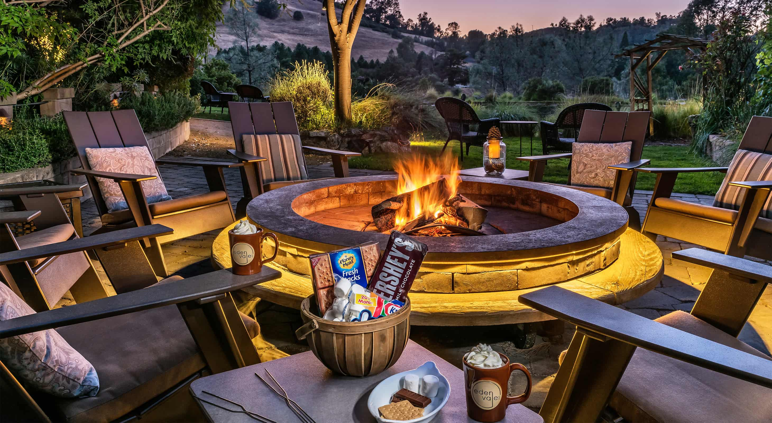 Fie pit at night with basket for S'Mores