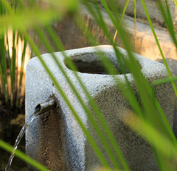 concrete fountain in the garden
