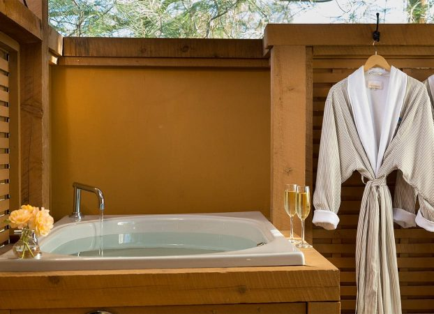 Outdoor tub in Gray Pine with robe on side