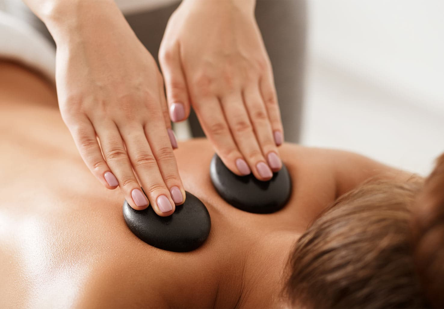 close up of hot stone massage