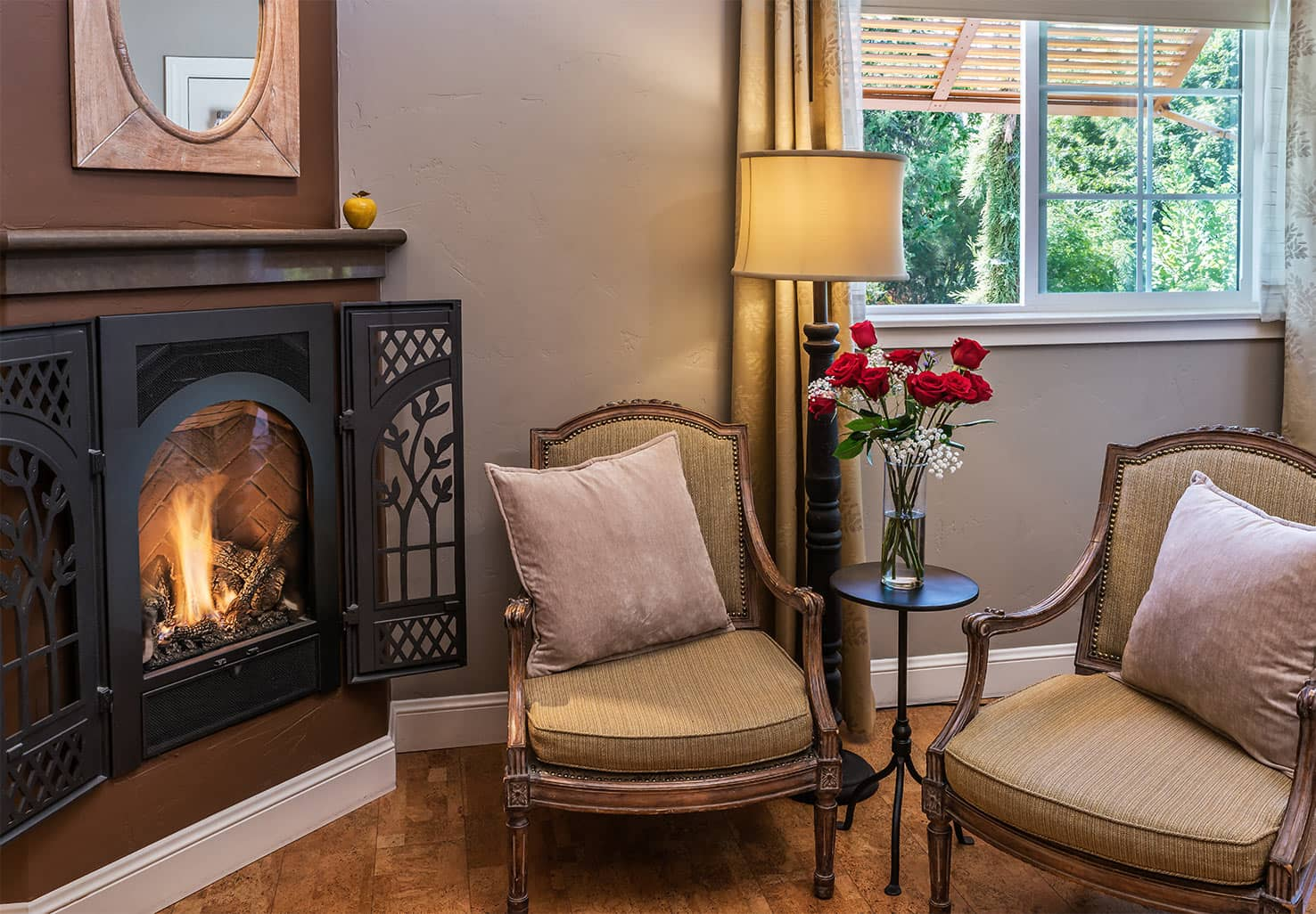 Red Roses by Fireplace in Madrone Room