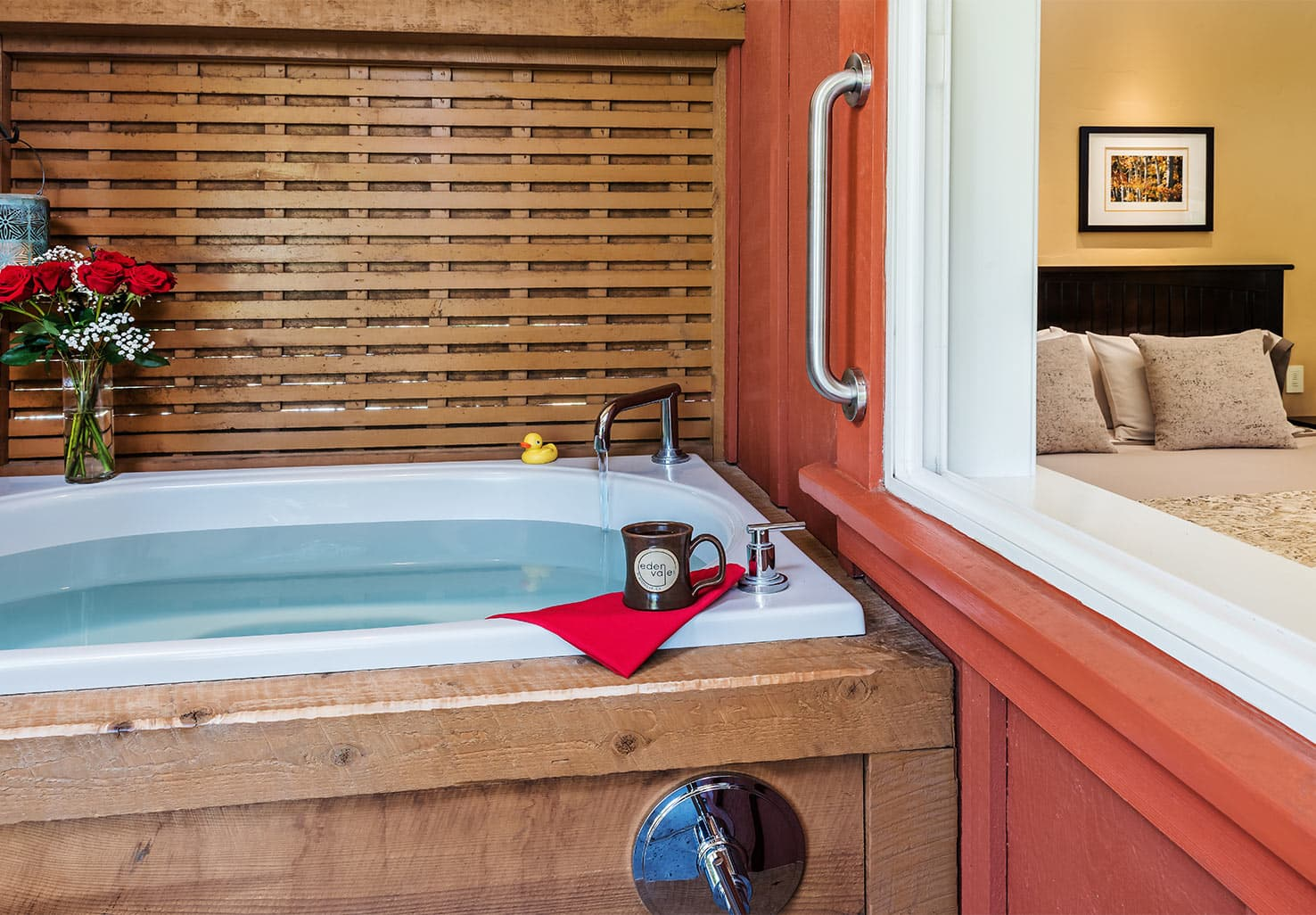 Madrone Room showing outdoor tub and view of bed