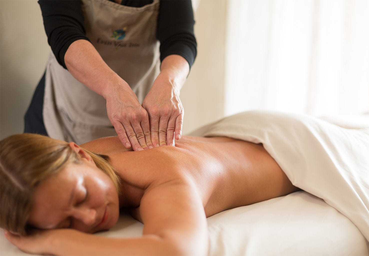 Woman receiving a deep tissue massage