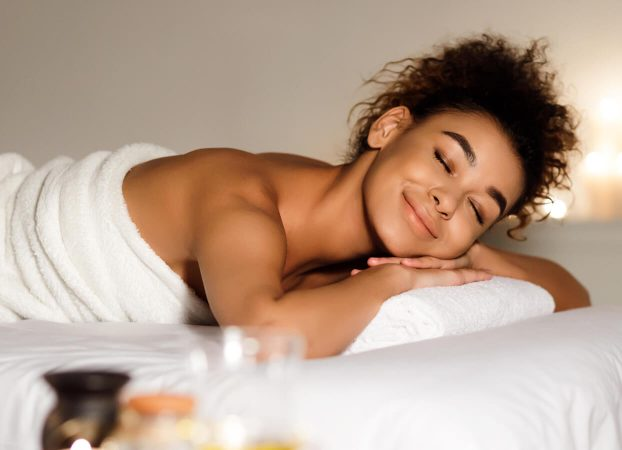Smiling African American woman in a spa relaxing