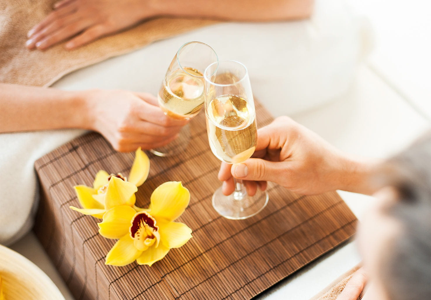 Wine glasses toasting during couples massage