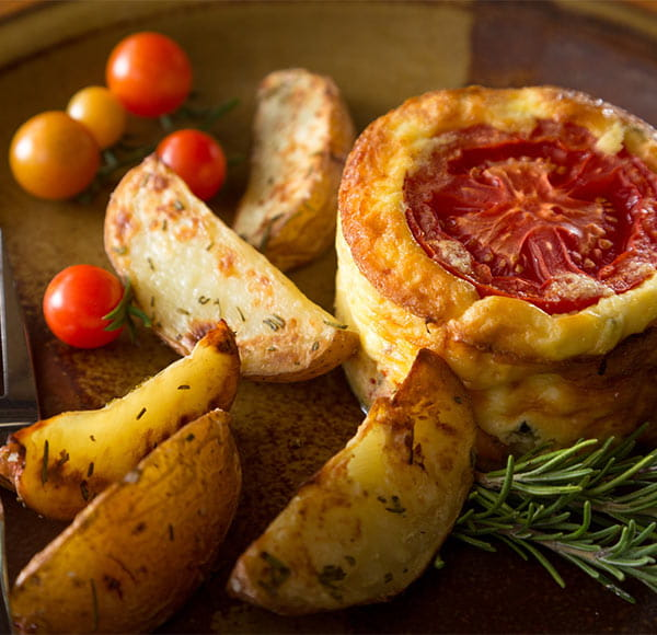 Quiche with tomatoes and potatoes