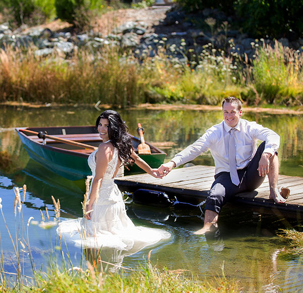Bride walking into the pond