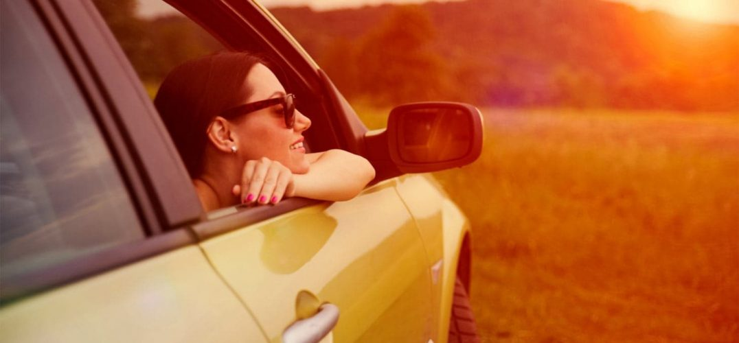 Woman looking out passenger side of car