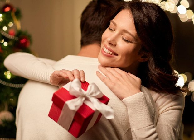 Smiling woman receiving a gift box