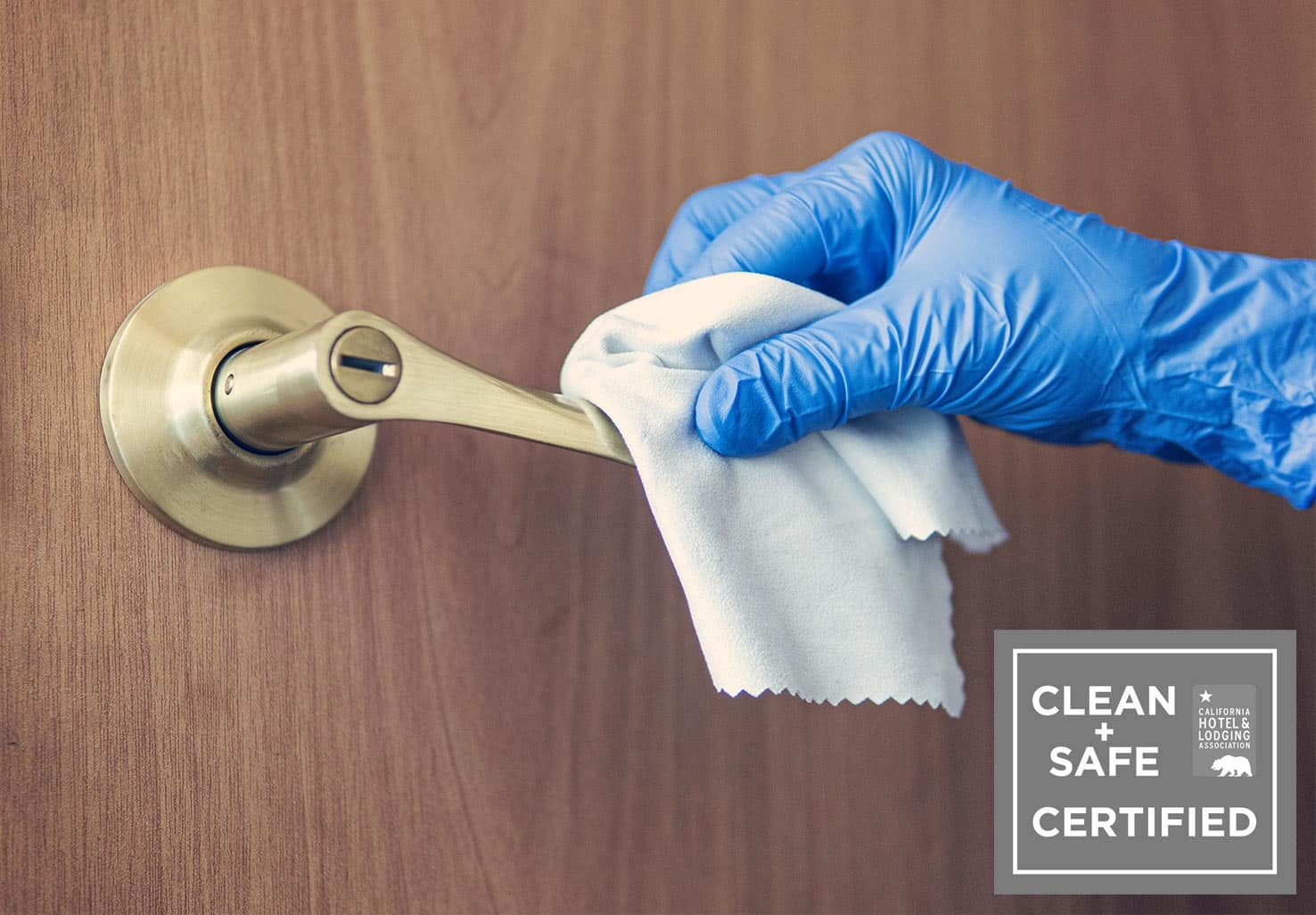 Maid cleaning doorknob at our Placerville, CA Bed & Breakfast
