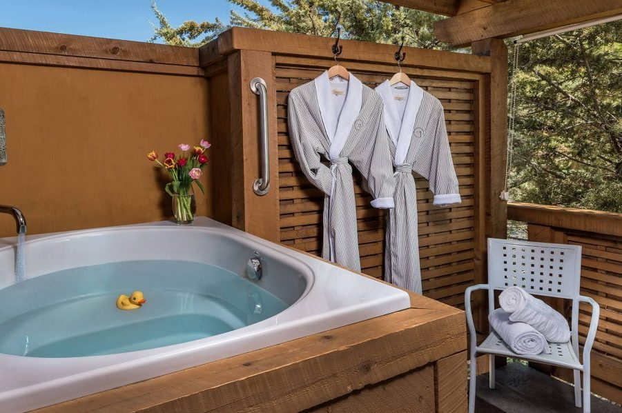 hot tub with hanging bathrobes