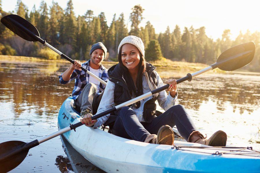 couple near sacramento on a lake kayaking