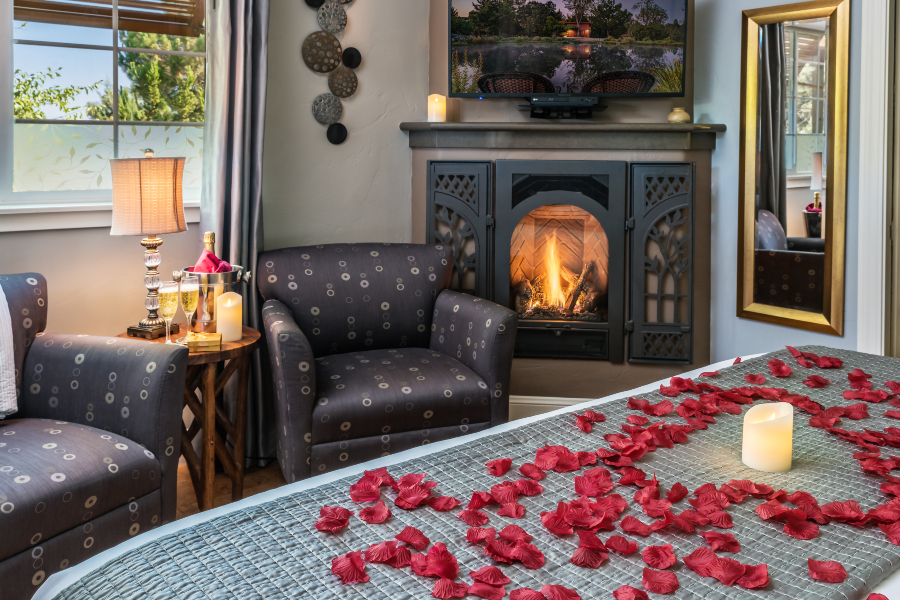 bed with rose petals and fireplace