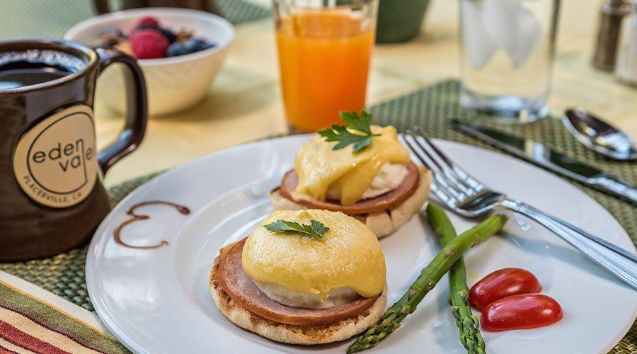 Gourmet breakfast of Eggs Benedict, juice and coffee