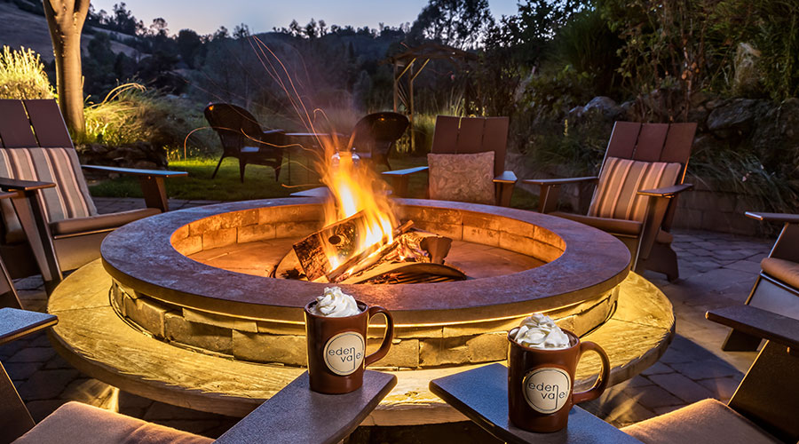 Fire pit at sunset with two mugs of hot chocolate