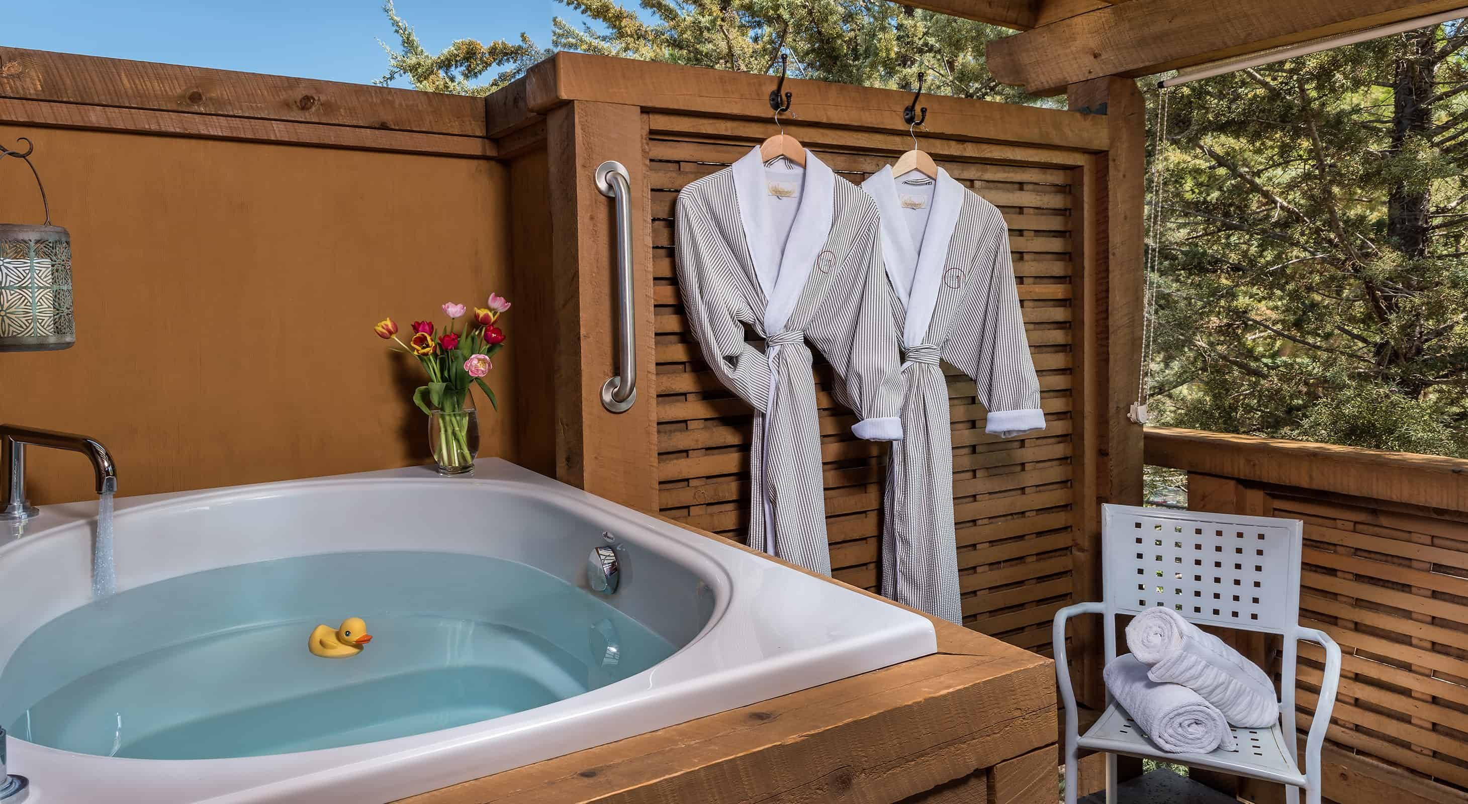 Outdoor soaking tub with two bathrobes