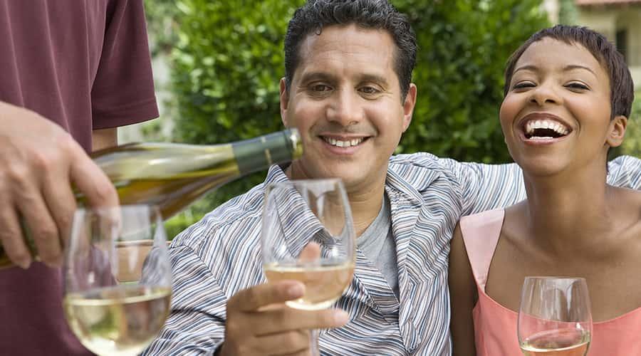 Couple wine tasting on a northern California fall getaway