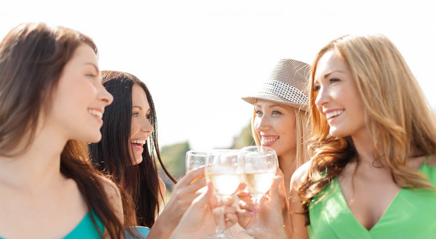 Smiling friends with wine glasses at a Placerville festival