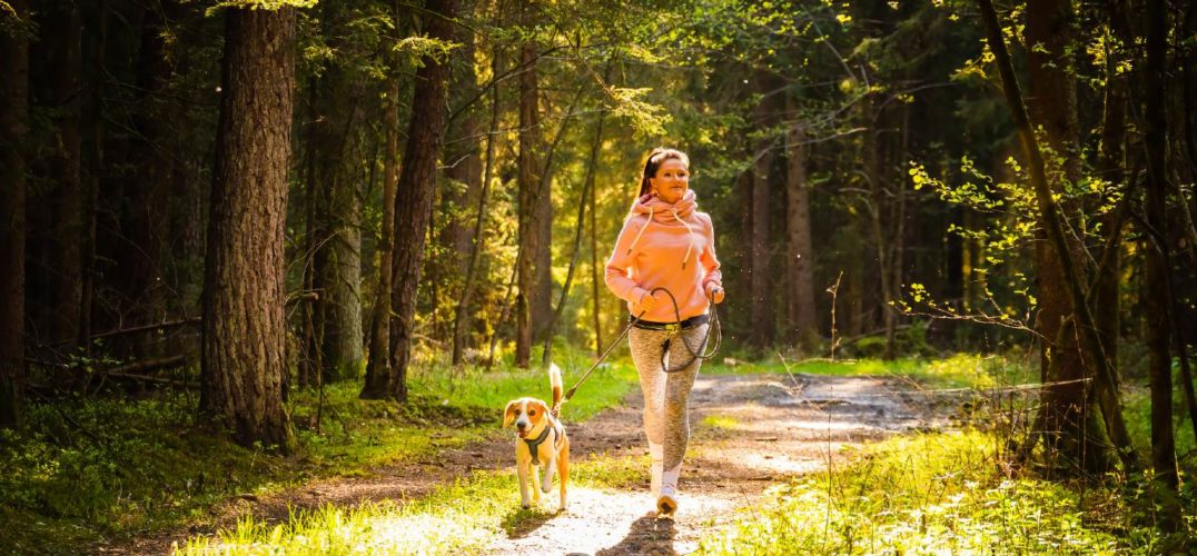 woman and dog running in Placerville, CA park